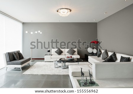 Interior Design: Living room with big empty wall - stock photo