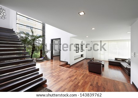 Interior design: Modern big living room and wooden stairs - stock photo