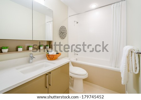 Interior design of a beautiful bright bathroom in a house hotel