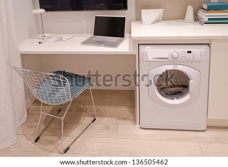 Interior design of a combination of a modern office and a laundry. For small condos. - stock photo