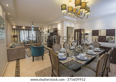 Interior design of a luxury apartment show home living area and lounge with dining table - stock photo