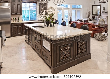 Interior design of a luxury stylish modern kitchen, counter with the living room at the back. - stock photo