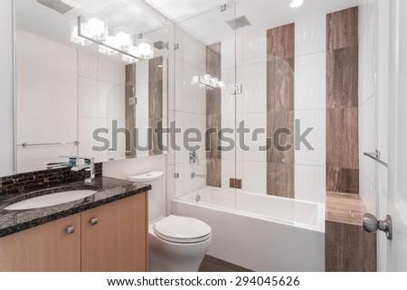 Interior design of a spacious and elegant bathroom. - stock photo