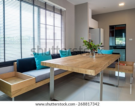 Interior design of minimalist modern dining room and kitchen - stock photo