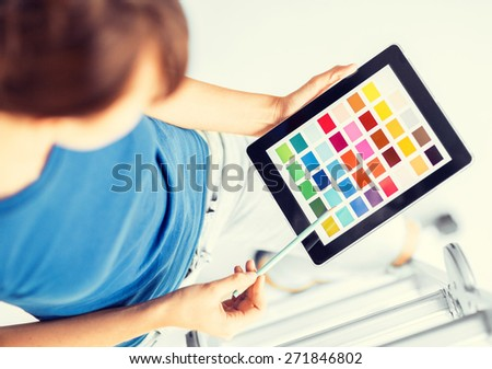 interior design, renovation and technology concept - woman working with color samples on tablet pc - stock photo