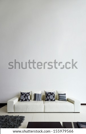 Interior design series: Modern living room with big empty white wall - stock photo