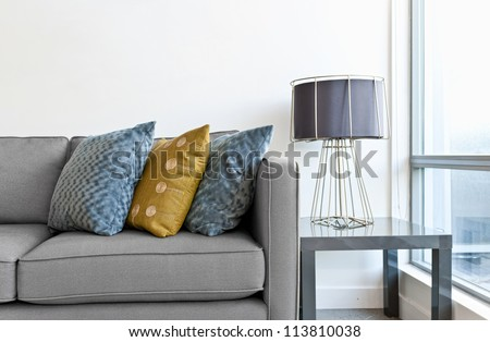 interior design couch colorful cushions lamp stock photo 113810038