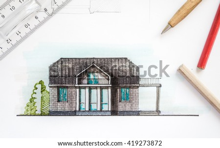 Nice Interior Designer Or Architect Hand Working With Blueprints Equipment  Objects And Color Image Of Drawn House