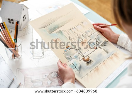 interior designer working on color hand stock photo 604809968 shutterstock - How Interior Designers Work
