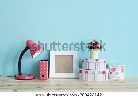 Interior detail. Home shelf with shabby chic decor on it over blue wall - stock photo