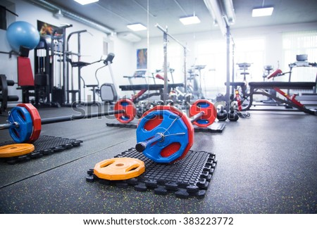 Interior gym with exercise equipment for fitness and bodybuilding - stock photo