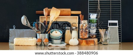 Interior Kitchen Table Top Rustic Country Wooden Metal Dishes Table Ware Fresh Grocery Different Stuff Black Background - stock photo