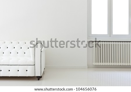 interior, leather sofa  in white room, detail - stock photo