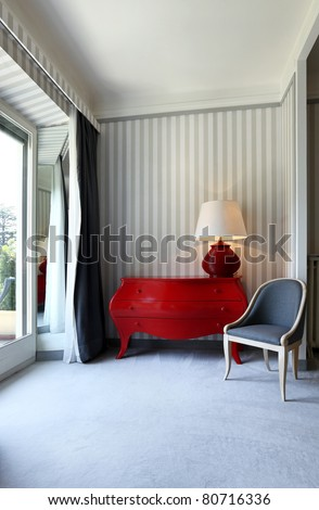 interior luxury apartment, detail room, dresser and chair - stock photo