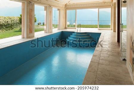 Interior, luxury villa, pool decorated with frescoes - stock photo