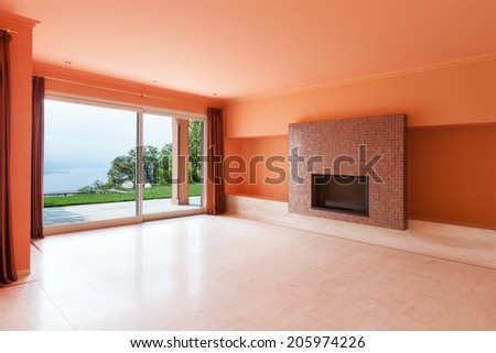 Interior, luxury villa, wide living room with fireplace - stock photo