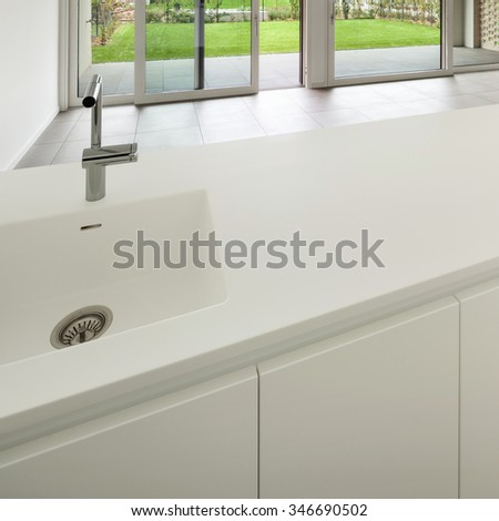 Interior, modern domestic kitchen, white counter top - stock photo