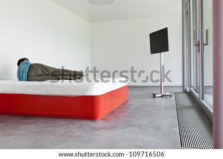interior modern hotel room, guy lying on the bed