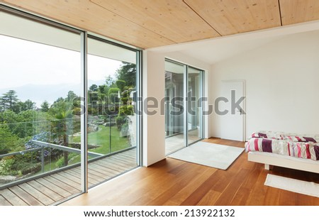 Interior, modern house, bedroom with balcony