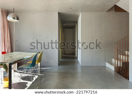 Interior modern house, dining room, concrete wall - stock photo
