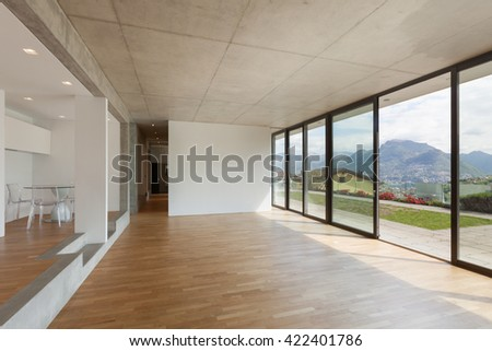 Interior, modern kitchen of concrete apartment, parquet floor - stock photo
