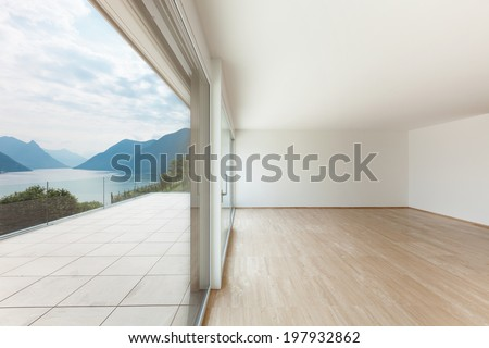 Interior, modern penthouse, empty living room with large window - stock photo