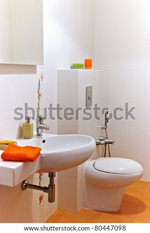 Interior of a bath room with sink and bawl - stock photo