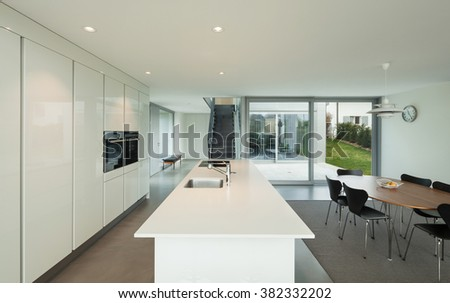 Interior of a beautiful modern house, wide domestic kitchen - stock photo
