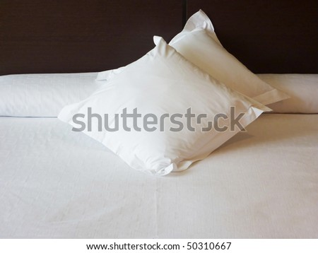 Interior of a bedroom with soft white pillows - stock photo