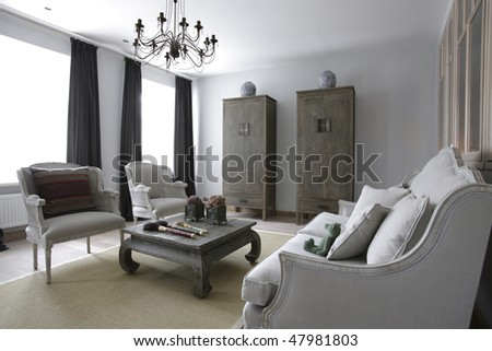 interior of a big wide and bright living room - stock photo