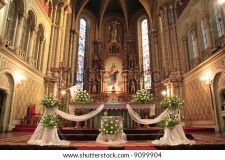 Interior catholic church beautifully decorated wedding stock photo interior of a catholic church beautifully decorated for a wedding ceremony junglespirit Images