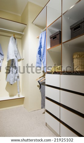 interior of  a closet with drawers and shelves wood - stock photo