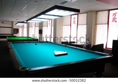 Interior of a club having billiard tables - stock photo