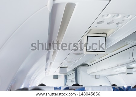 Interior of a commercial airplane - stock photo