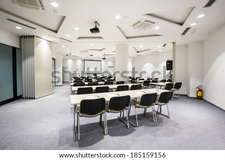 Interior of a conference hall  whit modern ceiling lights - stock photo