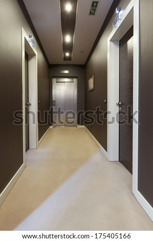Interior of a corridor with a view to elevator door - stock photo