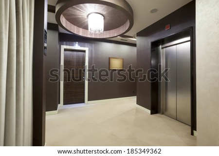 Interior of a corridor with passenger lift door - stock photo