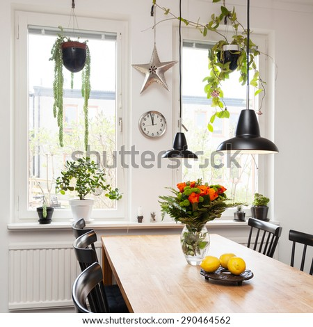 interior of a fancy kitchen with kitchen table  - stock photo