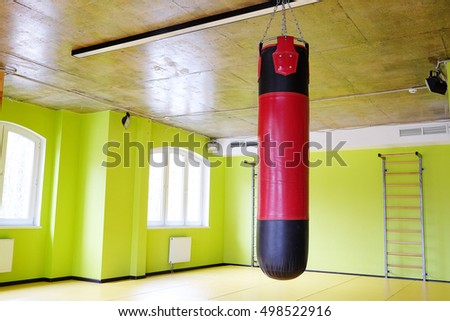 Interior of a fitness hall with a punching bag