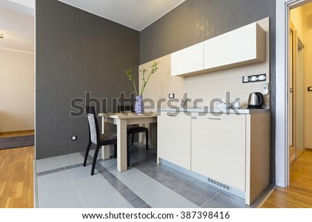 Interior of a hotel room with kitchen - stock photo