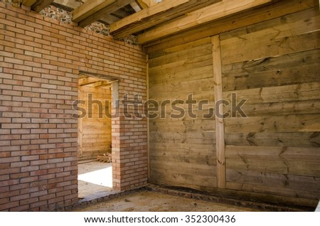 Interior of a house under gut renovation at construction site - stock photo