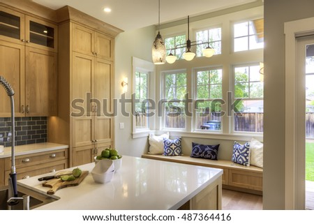 Interior of a kitchen with large windows and beautiful craftsmanship