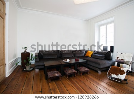 interior of a living room with a big sofa - stock photo
