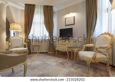 Interior of a living room with antique furniture - stock photo