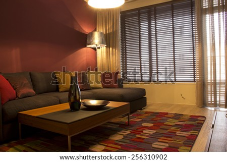 Interior of a living room with big sofa and table.