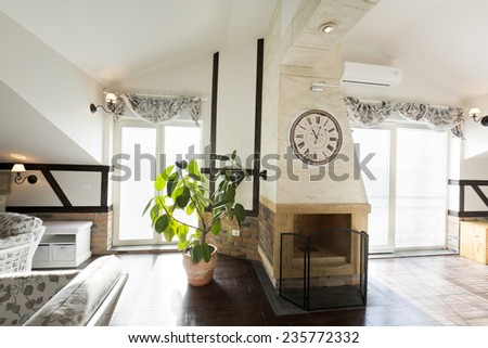 Interior of a living room with fireplace - stock photo