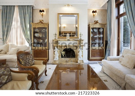 Interior of a living room with fireplace in luxury villa - stock photo