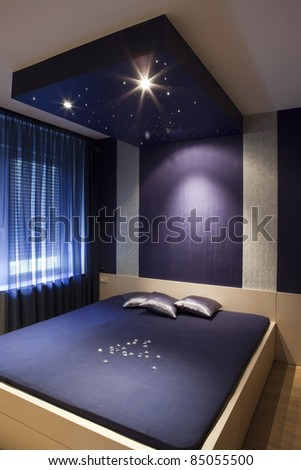 Interior of a luxury bedroom - stock photo