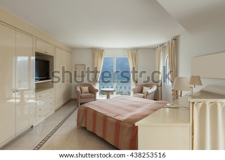 Interior of a luxury home, comfortable bedroom - stock photo