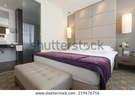 Interior of a luxury hotel bedroom with bathroom - stock photo